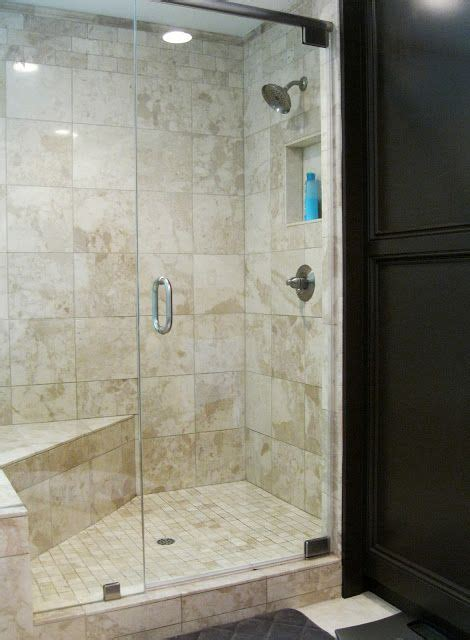 Master bath shower= simple travertine, bench and built ins