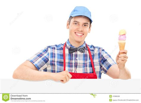 man holding ice cream cone young cheerful man holding an ice cream stock photo