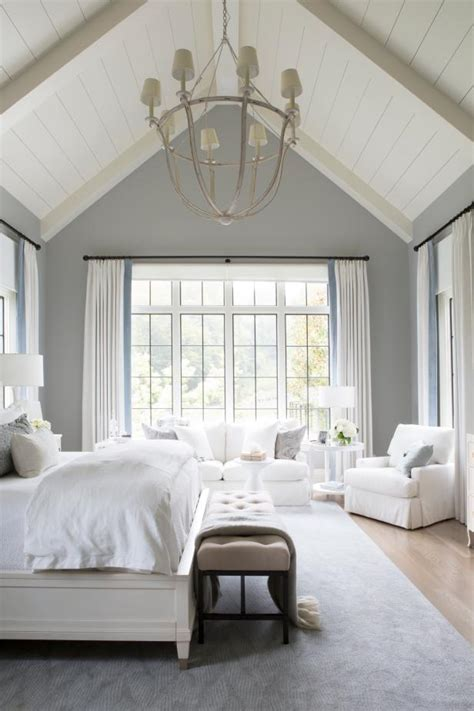 transitional neutral master bedroom  vaulted ceilings