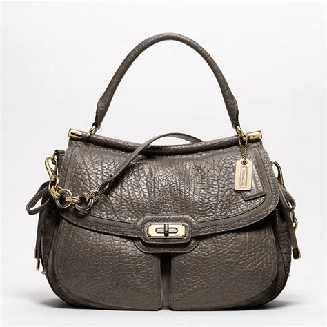 couch perses coach new flagship buffalo leather dowel flap shoulder bag