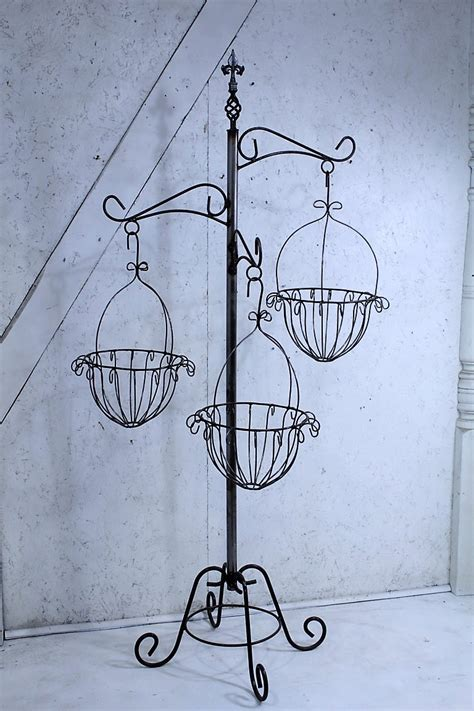 black rod iron christmas tree stand wrought iron tree with baskets flower plant stand