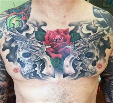 tattoo chest gun guns and roses tattoos designs ideas and meaning