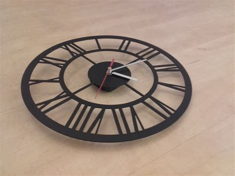 a swallow carries a key above a broken compass in this new interesting clock designs 40 coolest and strange clocks