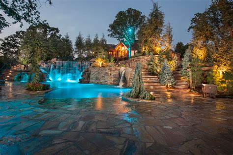 Mountain Mine Themed Pool With Waterfalls, Slide and More Rustic Pool Oklahoma City by