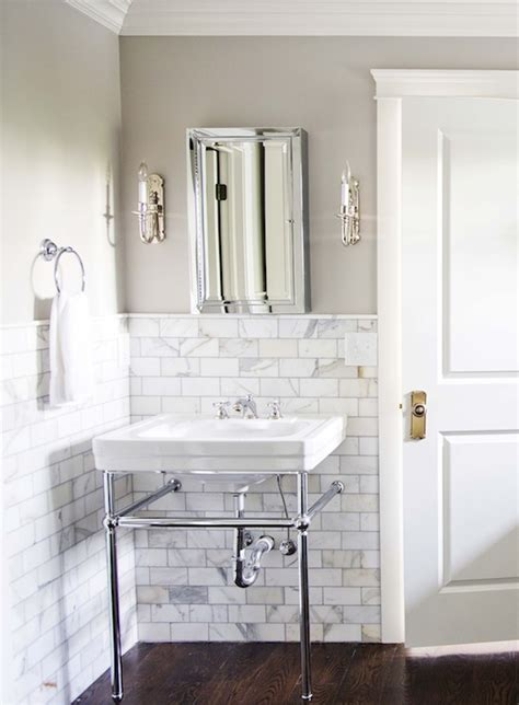 stunning master bathroom with gray walls paint color calcutta gold marble subway tiles