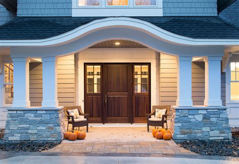 shingle style home with casual coastal interiors home
