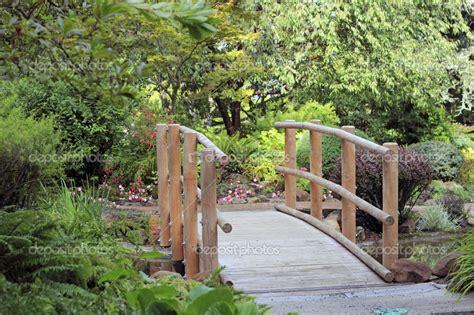 small wooden bridge bridges wooden bridge over water