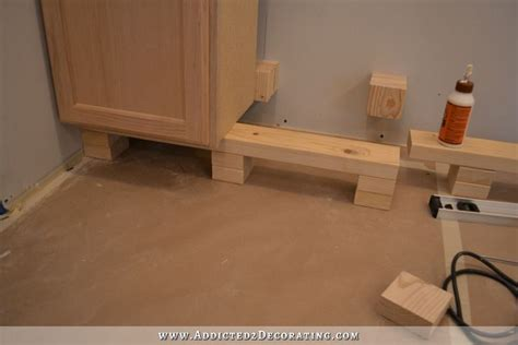 how to level kitchen base cabinets peninsula cabinet installation almost finished