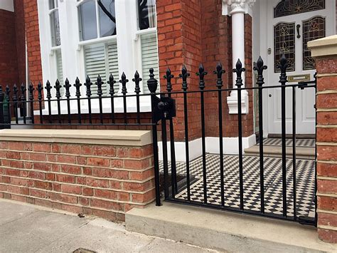 red brick front garden wall heavy rails gate victrorian