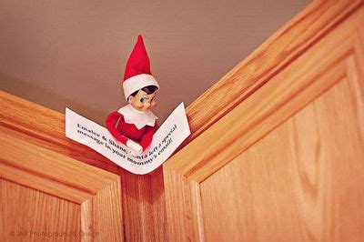 Santa On A Shelf by Our On The Shelf Carrying A Letter From Santa Saying