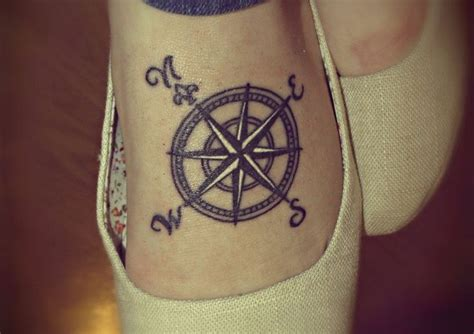 discover the 17 small compass tattoos and their meanings
