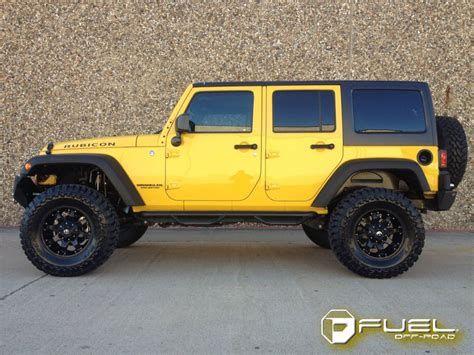 yellow jeep jeep wrangler with 20in fuel krank wheels flickr photo
