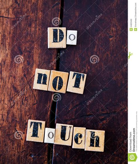 Did Spelling A Out by Antique Spelling Tiles Spell Do Not Touch Stock Photo