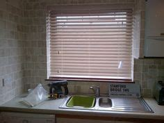 blinds for kitchen window sink 1000 images about wooden blinds on venetian