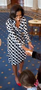 First lady looks absolutely incredible in a black and white wrap dress
