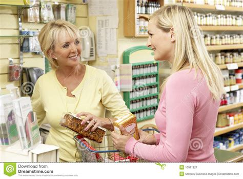 sales assistant with customer in health food store royalty free stock photography image 10971927