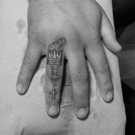 finger tattoo guys picture of tiny tattoo on the finger