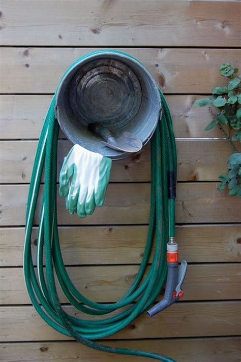 Garden Hose Storage Ideas Build A Beautiful Garden Hose Storage With Planter Diy Hose Storage