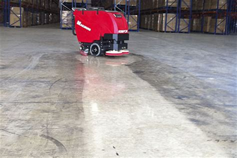 Concrete Floor Cleaning by Floor Scrubber Magnum Walk Scrubber Cleaning