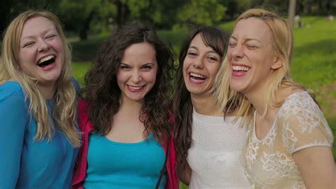 group teen girls laughing closeup of fun teen girls pose make funny faces for