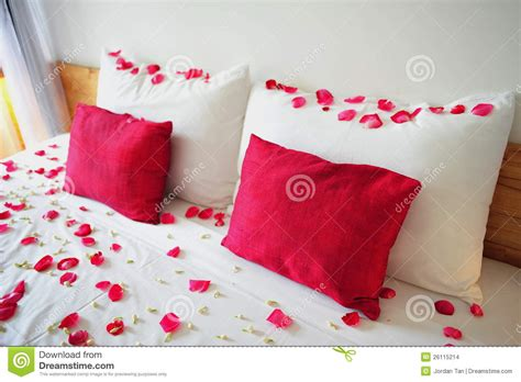 rose petals on bed bed filled with rose petals stock images image 26115214