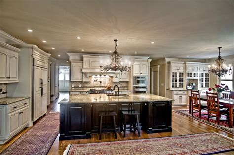 oversized kitchen islands painted kitchen featuring oversized black island traditional kitchen by kirkland custom