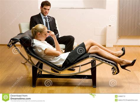 job couch psychiatrist examining a female patient stock photography