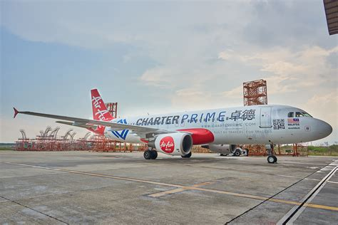 airasia update news charterprime launches custom livery with airasia newswire