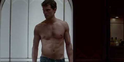 first look at fifty shades of grey leads as film pushed fifty shades of grey trailer first look at jamie dornan