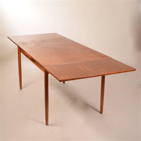 modern draw leaf extendable dining table at 1stdibs