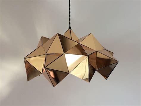 geometric pattern hanging light gold mirror half geometric sculptural pendant light