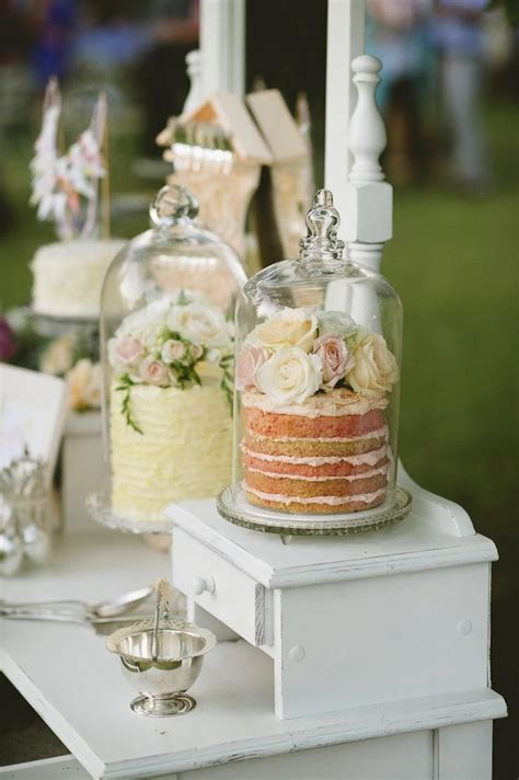 wedding cake table ideas wedding cakes displayed in apothecary jars unique wedding ideas inked weddings