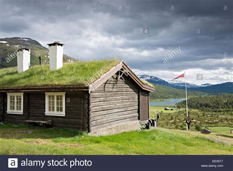 log and sod roof a sod roof log cabin with grass on top and two chimneys
