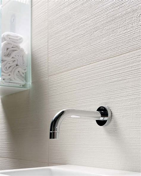 White Textured Bathroom Tiles by Textured White Tile Bathroom Ideas