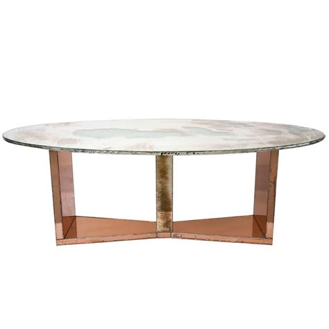 butterfly dining table wood base coated silvered glass and