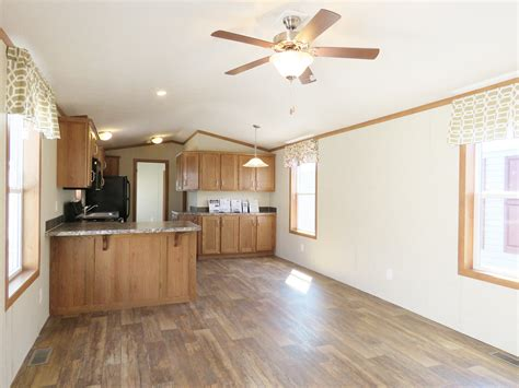 family room with a double wide mobile home floor plans 3 4a154a single wide manufactured home living room
