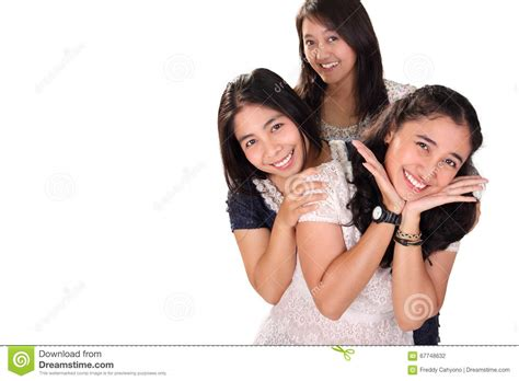stylish quates poses girlz three girls pose together over white copy space stock