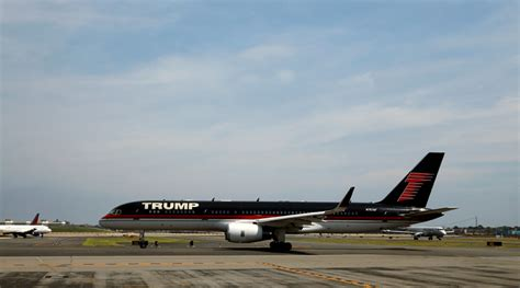 trump s plane trump s plane given water cannon salute at ny airport he