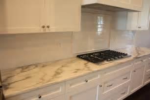 Laminate Countertops And Backsplash Ideas - minimalist kitchen with carrara marble laminate countertops white subway tile backsplash design