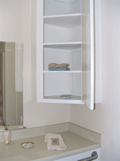 Corner Cabinet Bathroom Storage Furniture White Painted Wooden Bathroom Corner Wall Storage Cabinet Using Door And Storage