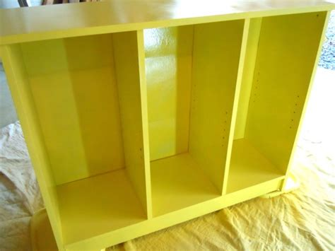 spray paint bookshelf painting a laminate bookshelf