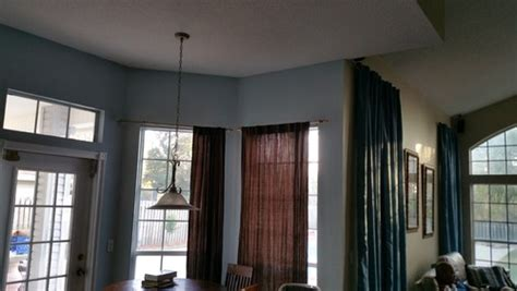 cornered windows different ceiling height drape dilemma