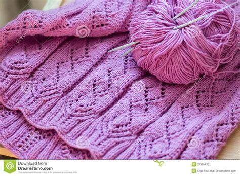 Handmade Woolen Design - detail of pink woven handicraft knit sweater stock photo