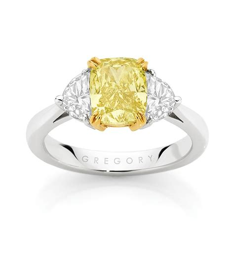 Cushion cut fancy yellow diamond engagement ring   Rings