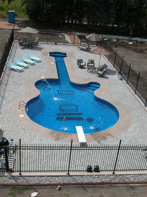 backyard instruments backyard instrument pools les paul custom guitar aqua