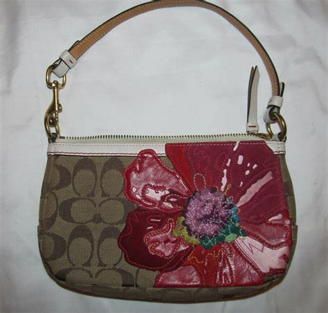 coach monogram limited edition poppy applique flower demi