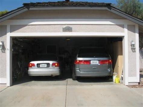 Car In Garage by What You Need To About Garage Doors Milton Ga