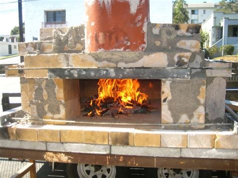build a wood fired pizza oven in your backyard how to build a temporary wood fired brick pizza oven with cheap easy to find materials
