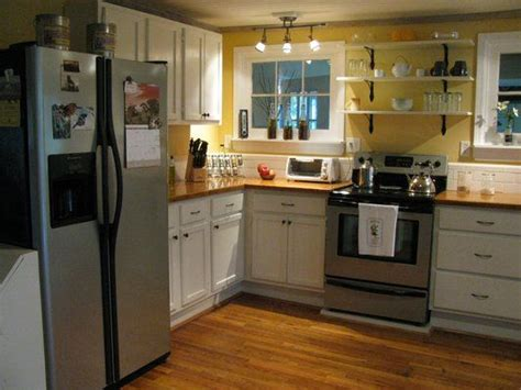 white cabinets wood countertops 1940 s farmhouse kitchen