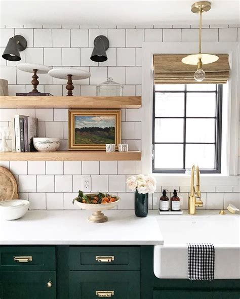 kitchens with shelves green white tile open shelving farmhouse sink and dark green